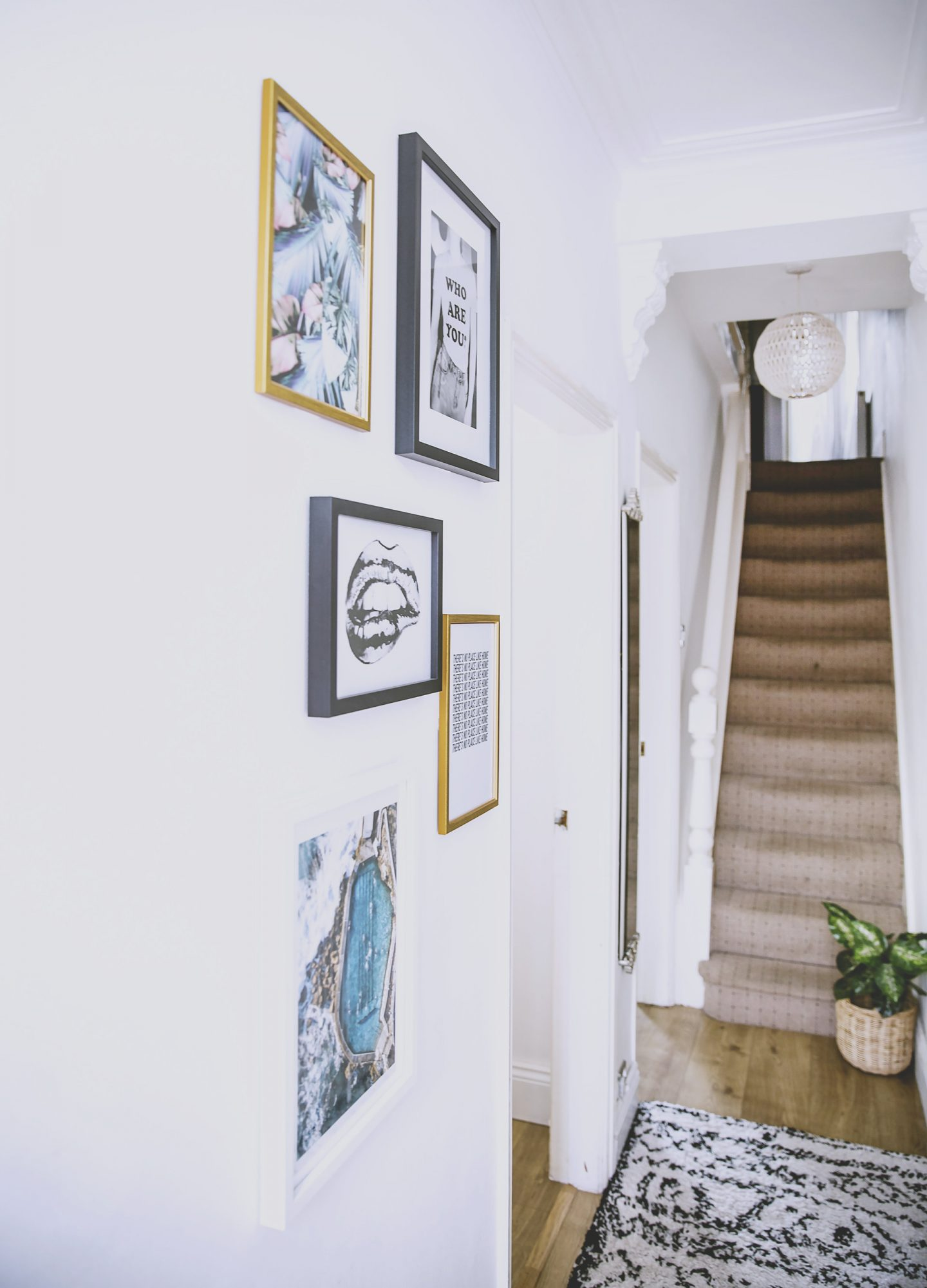 hallway with rug and gallery wall