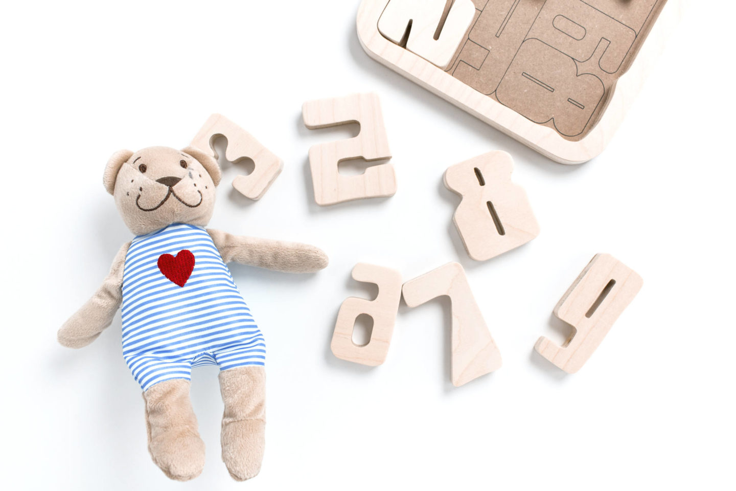 teddy bear and wooden puzzle