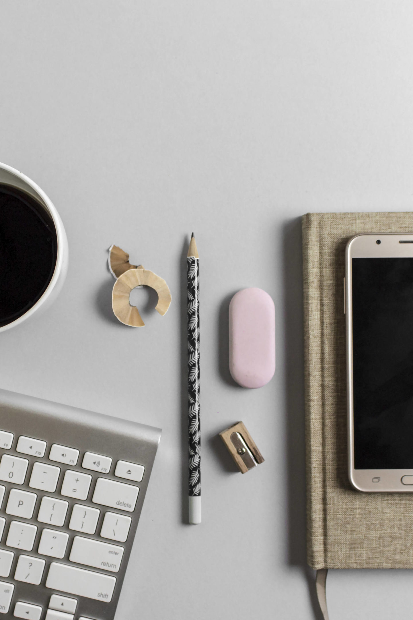 stationery and phone on desk