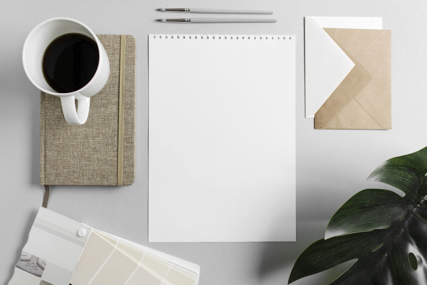cup of coffee and notepad on desk