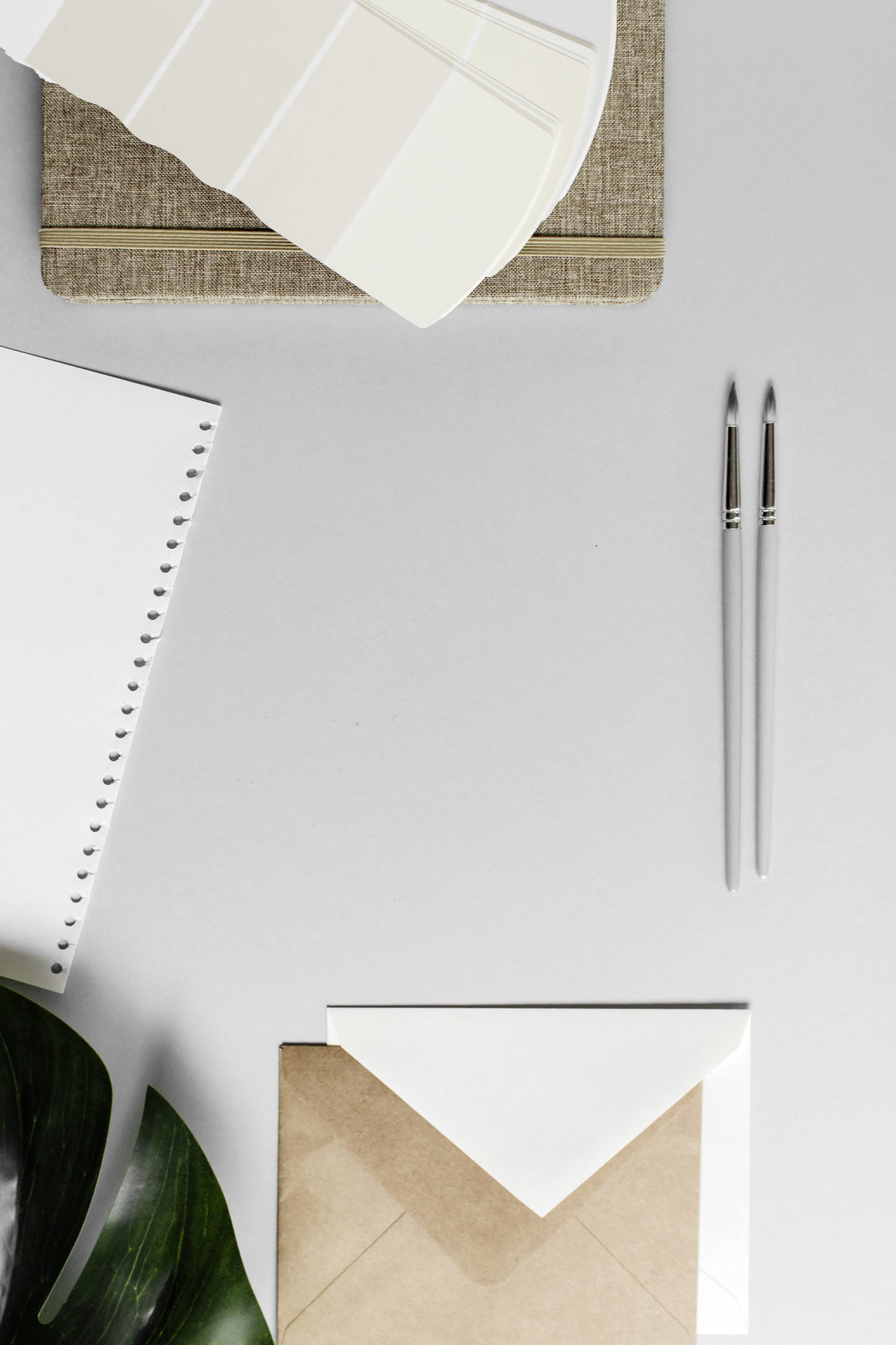 notepad and pens on desk
