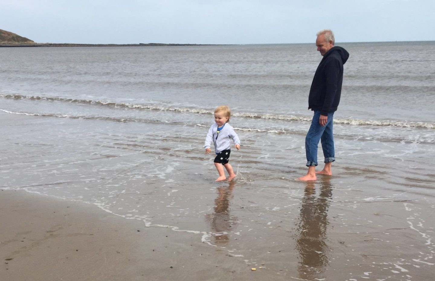 toddler and man on beach