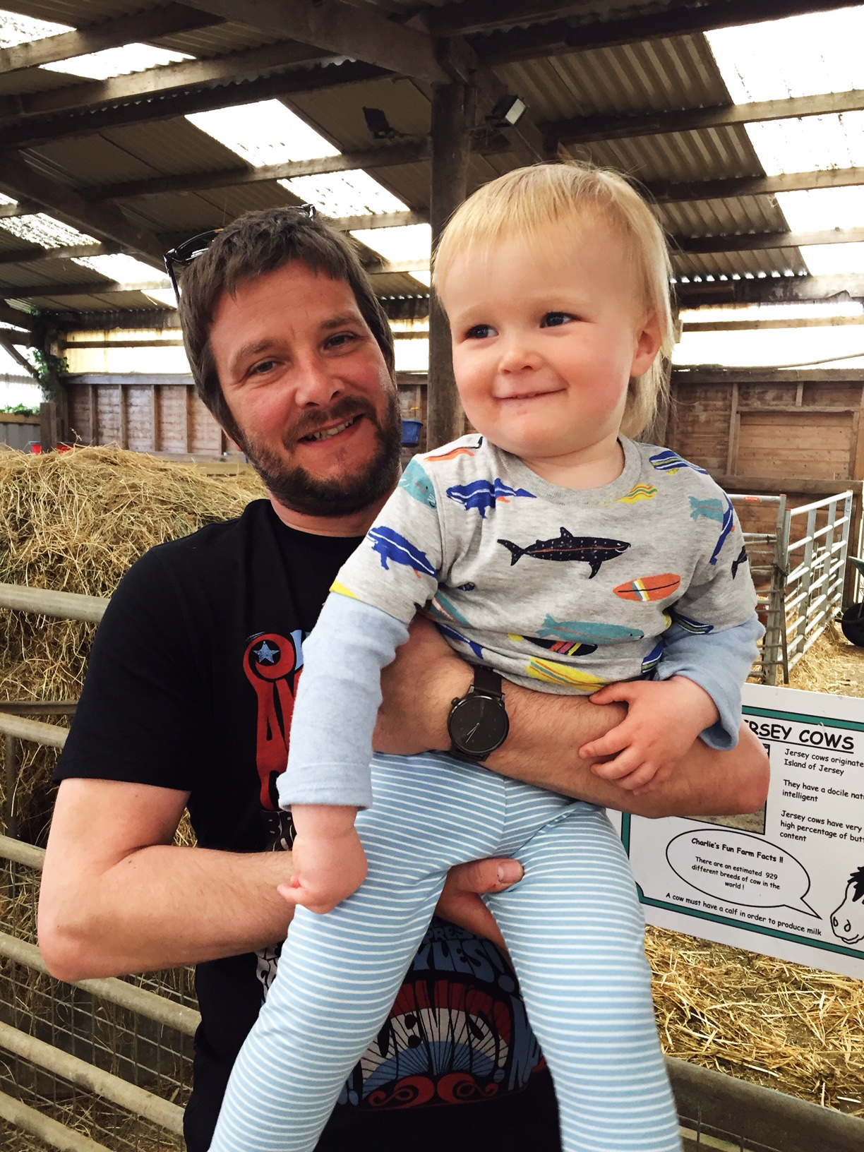 father and toddler boy on farm
